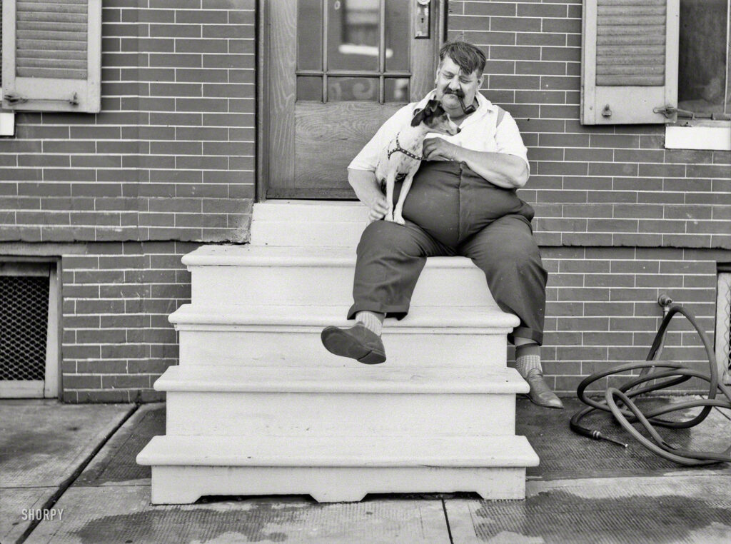"July 1938. ""Man who lives in row house. Baltimore, Maryland."" Walkies, anyone? Photo by John Vachon for the Resettlement Administration."