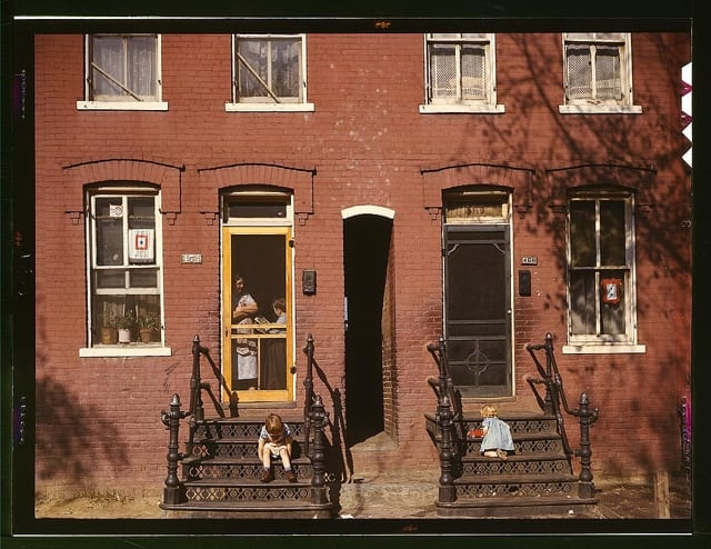 Children on rowhouse steps