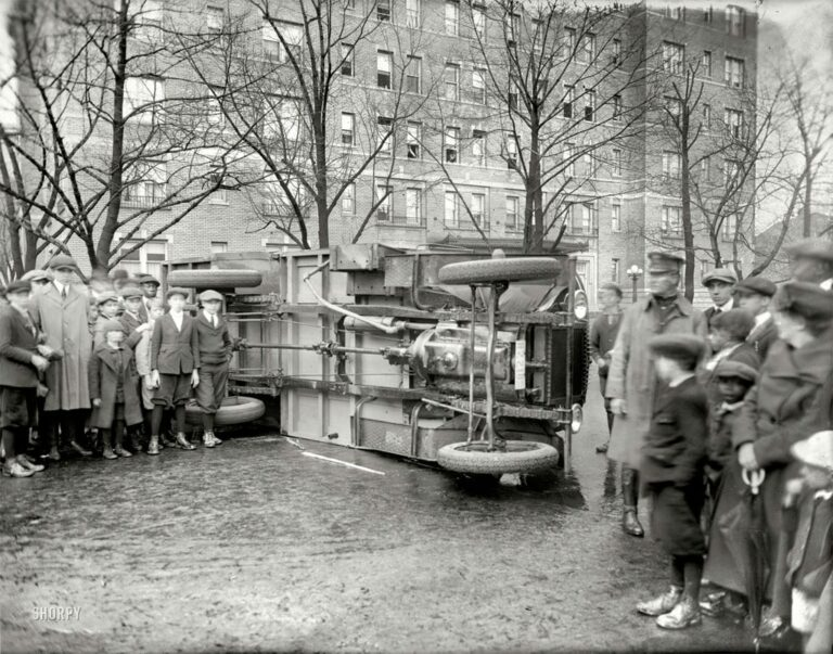 Overturned bus in Petworth (1921)