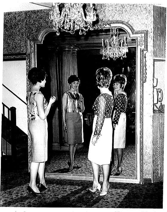 Ladies admiring themselves in the mirror - maybe early 70s