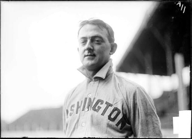 Half-length portrait of Charles Moran, baseball player for the American League Washington Senators, standing at South Side Park which was located at West 37th Street, South Princeton Avenue, West Pershing Road (formerly West 39th Street), and South Wentworth Avenue in the Armour Square community area of Chicago, Illinois.
