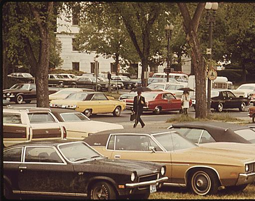 Cars parked on the grass (1974)
