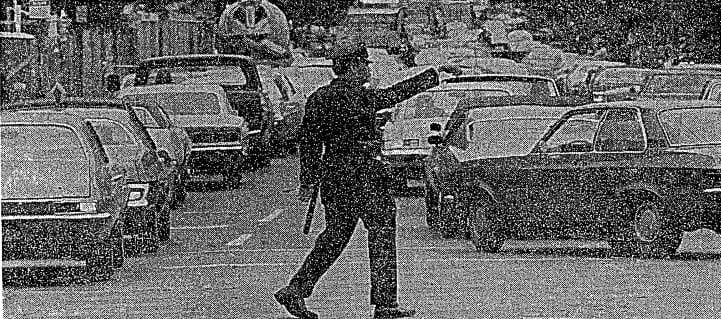 Policeman directing traffic (1975)