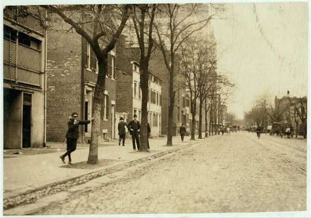 View of Red Light District on C. Street, N.W., near 13th, with Griffin Veatch, who was showing me around. No. 6 Special Messenger Service, 1223 New York Ave., N.W.; he lives 1643 Cramer St., N.E. He said he commenced the messenger service at 11 yrs. old. Has worked all night a couple of years, and now works until 10 P.M. Is known to Truant Officers. Family has had trouble with him. Says he is 17 but doesn't look it. Quite profane, but (apparently) not very wise about this district although he says he goes to these houses occasionally. Location: Washington (D.C.), District of Columbia. (Library of Congress)