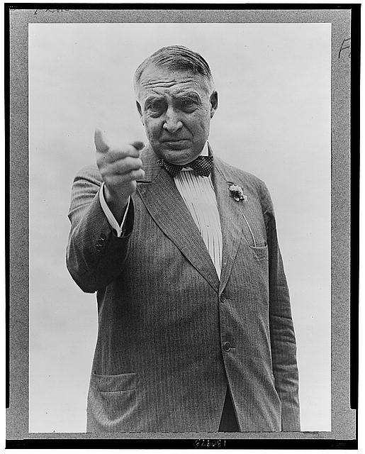 Warren Harding, half-length portrait, standing, facing front, gesturing with right hand