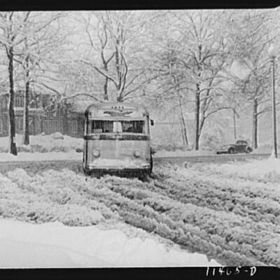 Bus going through the snow near Connecticut Avenue and Chevy Chase Circle