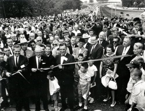 In Maryland, the final link in I-495, the Capital Beltway, was opened after ceremonies on August 17, 1964. Ribbon cutters (l. to r) are Rex Whitton, Governor J. Millard Tawes, and Chairman John B. Funk of the Maryland State Roads Commission.