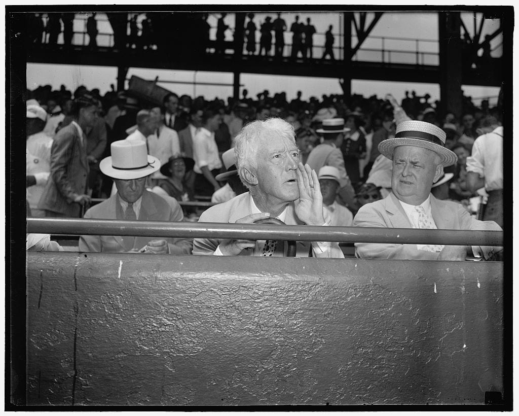Landis assumes camera pose. Washington D.C., July 7. Kenesaw Mountain Landis, High Commissioner of baseball, assumes his characteristic pose for the cameramen as he views the 1937 all-star game in the Capitol (Library of Congress)