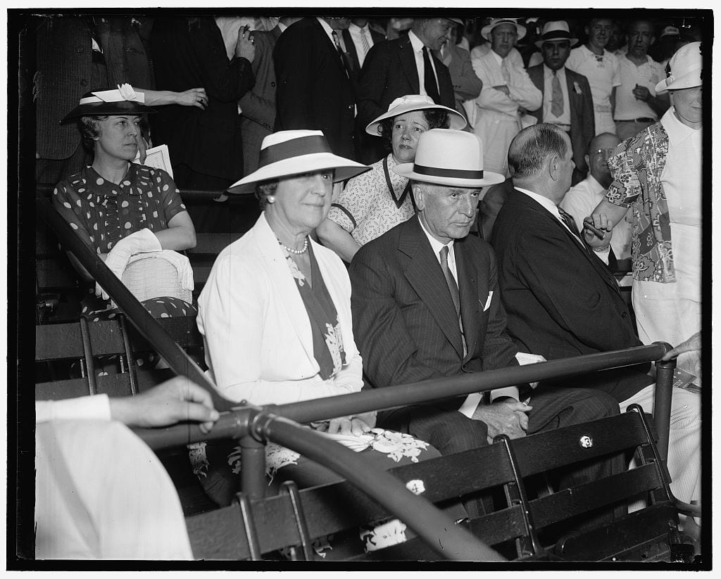 Secretary of State views All-Star game. Washington D.C., July 7. Secretary of State with Mrs. Cordell Hull joined the thousands of other rabid baseball fans at Griffith Stadium today to witness the 1937 All-Star Game (Library of Congress)