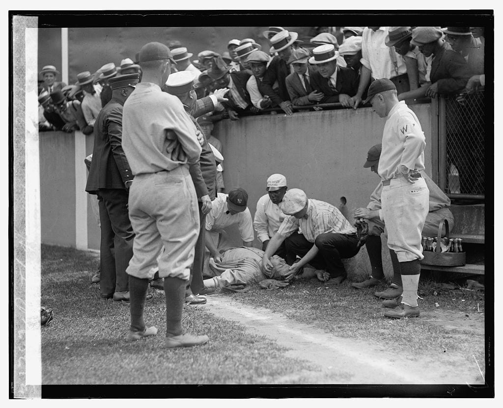Babe Ruth lying unconscious at Griffith Stadium - July 5th, 1924 (Library of Congress)