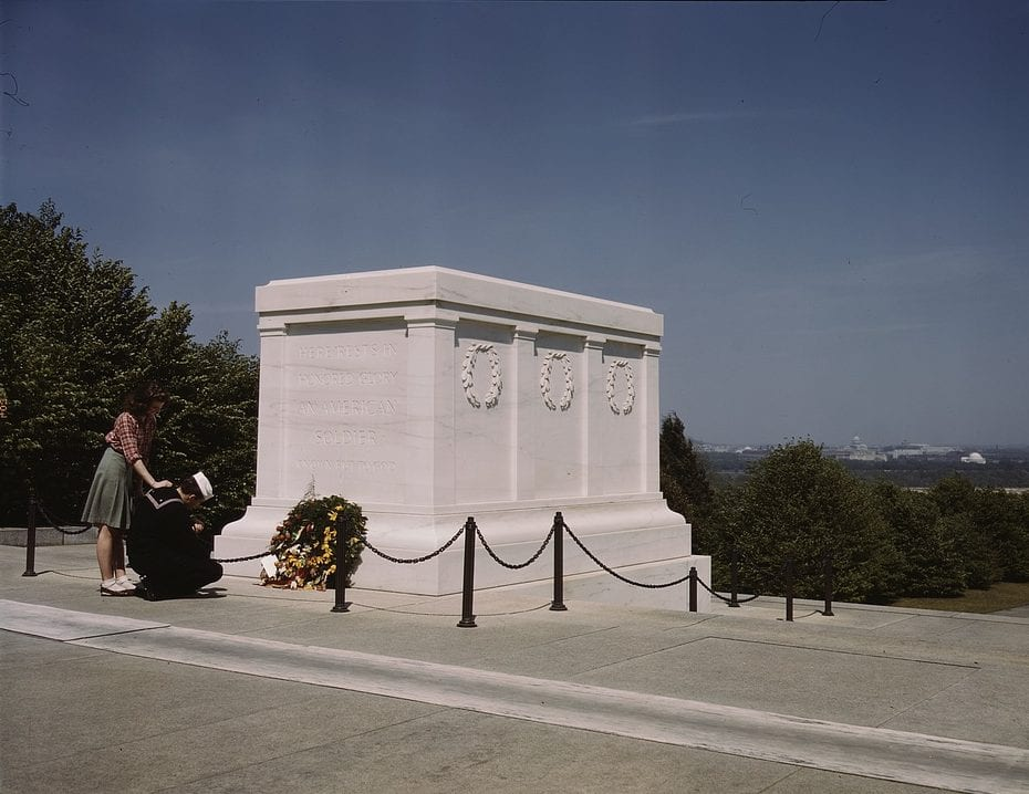 Sailor kneeling by the Tomb of the Unknown in 1943 (Library of Congress)
