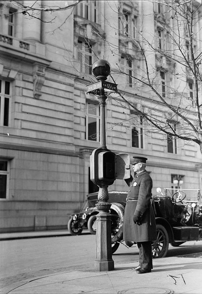 Police call box at 13 1/2 and D St. NW in 1912 (Wikipedia)