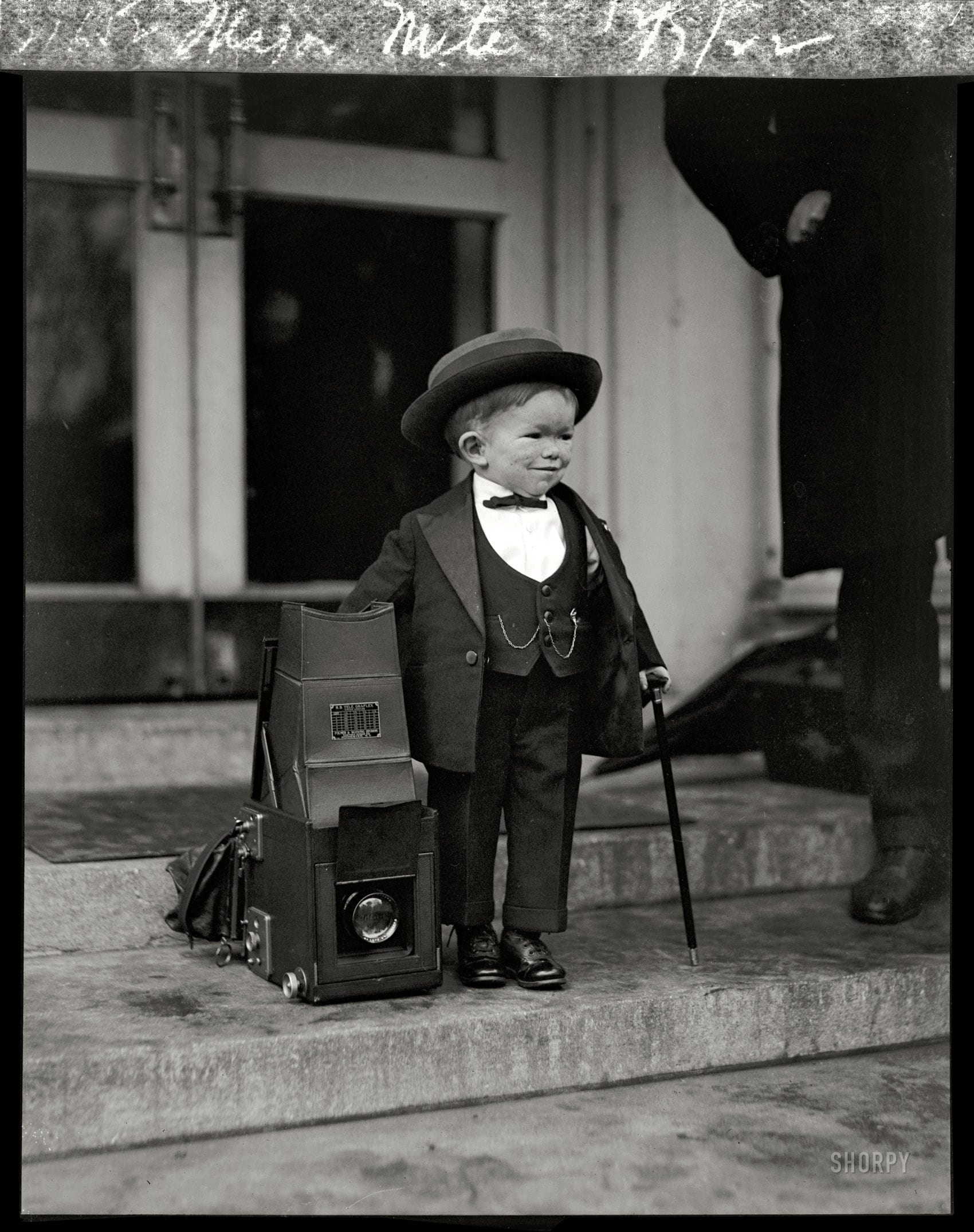 "December 7th, 1922. Washington, D.C. ""Two in one. The smallest midget and smallest 'camel' shriner in existence. Maj. Mite had to skirt the camera left carelessly by a photographer when leaving the White House."" Clarence Chesterfield Howerton (1913-1975), a.k.a. ""Major Mite,"" was 9 years old when this photo was taken. According to his obituary he was in the ""Our Gang"" movies and played a Munchkin in ""The Wizard of Oz."" National Photo Co."