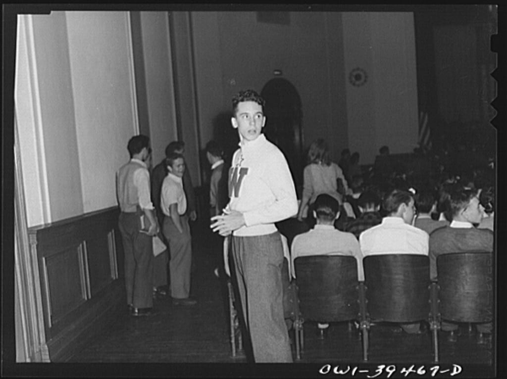 Walter Spangenberg acting as usher at a student assembly at Woodrow Wilson High School (Library of Congress)
