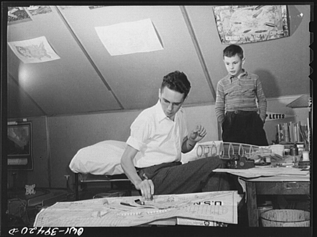 Walter Spangenberg, a student at Woodrow Wilson High School, with his nine year-old brother as he works on a model airplane at home (Library of Congress)