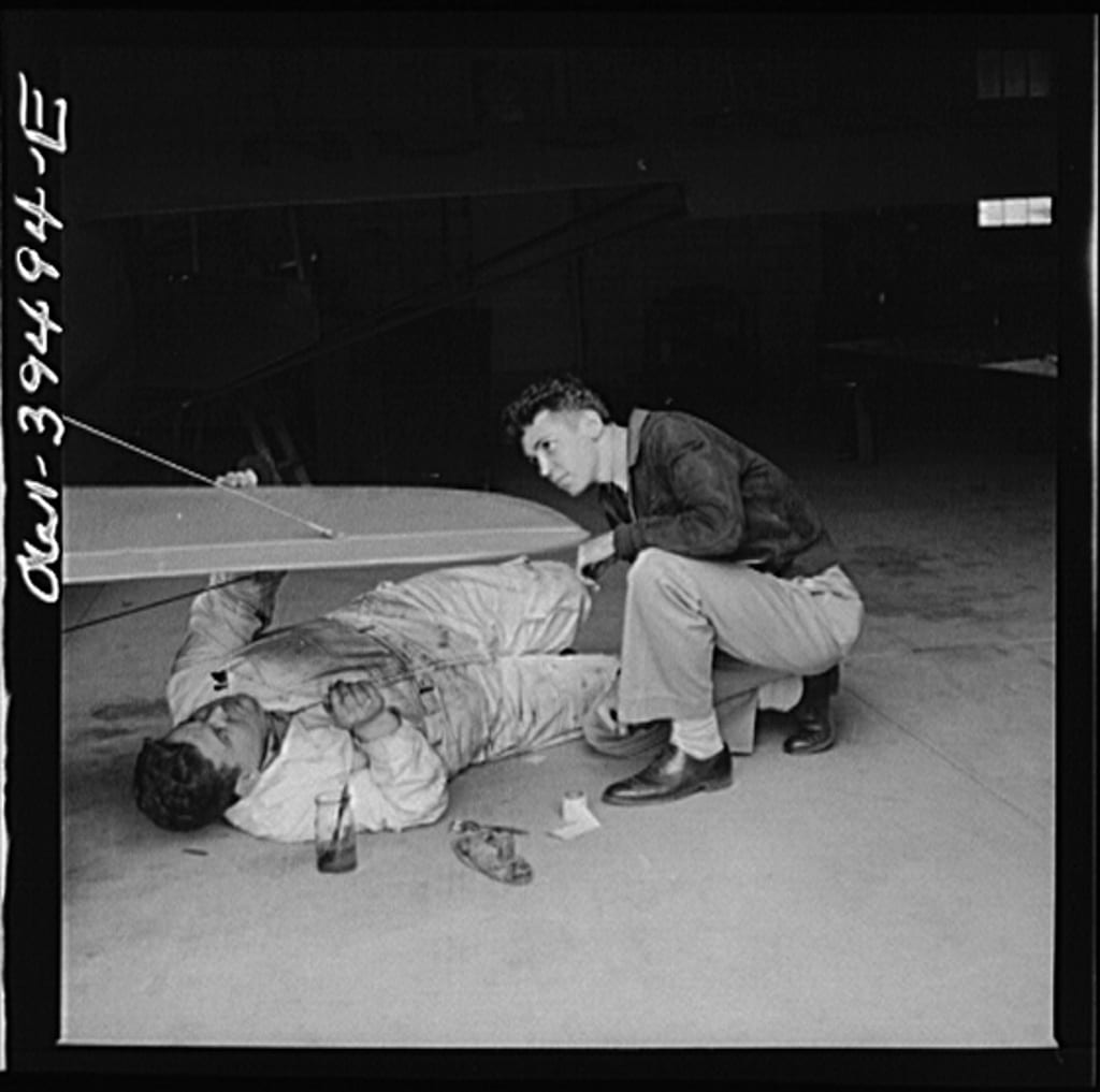 Frederick, Maryland. Walter Spangenberg, a student at Woodrow Wilson High School, watches a mechanic repairing a plane at the Stevens Airport (Library of Congress)