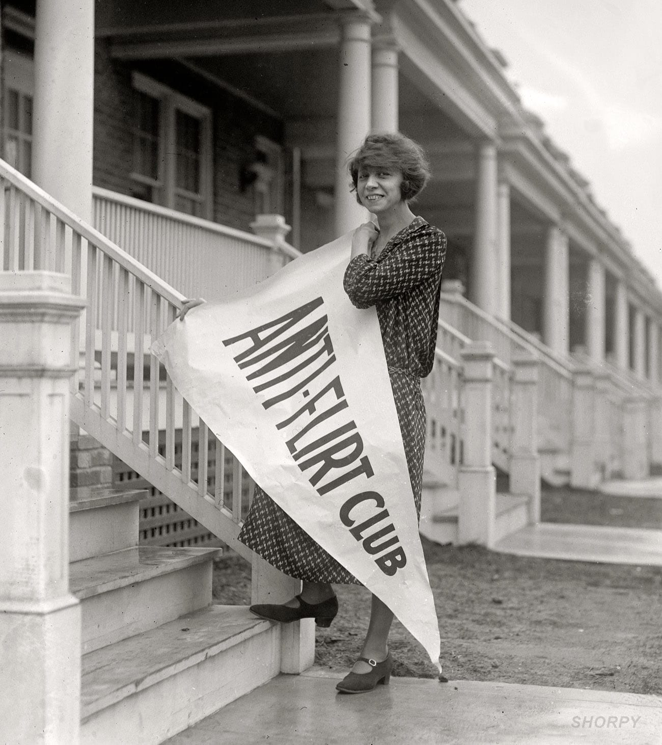 "February 27, 1923. ""Miss Alice Reighly, 1409 Harvard Street, president of Anti-Flirt Club, which has just been organized in Washington, D.C., and will launch an 'Anti-Flirt Week' beginning March 4. The club is composed of young women and girls who have been embarrassed by men in automobiles and on street corners."" National Photo Company Collection glass negative. (Shorpy)"