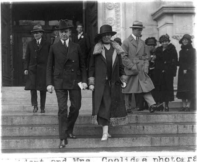 Calvin and Mrs. Coolidge leaving the Corcoran. Nobody is noticing. - 1925 (Library of Congress)