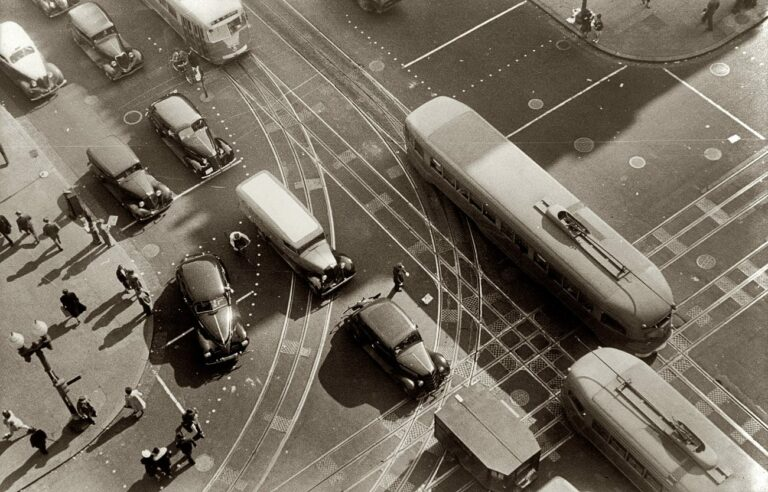 Aerial view in front of the Willard Hotel at 14th Street and Pennsylvania Avenue, showing pedestrians and rather dense traffic in autos and streetcars. - 1939