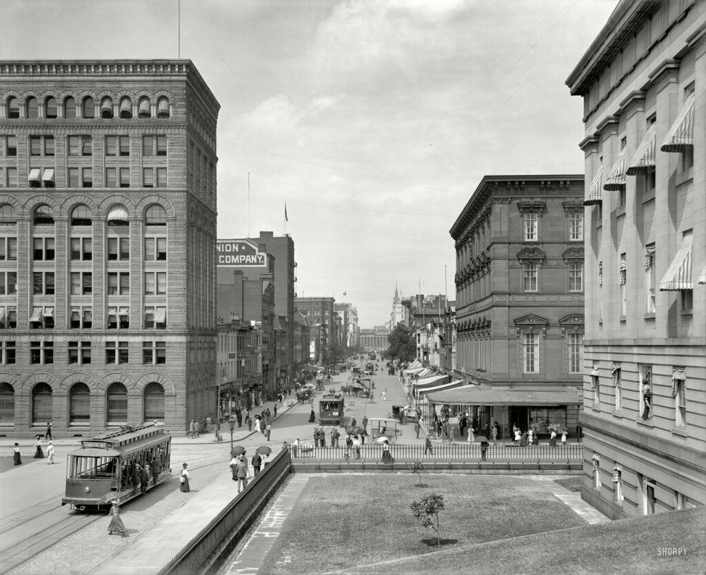 "Washington, D.C., circa 1908 ""F Street, looking toward Treasury."" Note the sign on the Lincoln Park streetcar advertising the ""hydraulic dive"" at Glen Echo. (Shorpy)"