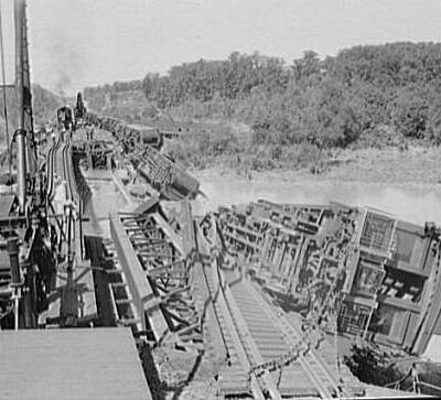 Wreck of the Crescent Limited train on the Pennsylvania Railroad Bridge over the Anacostia River in Washington, D.C., in the United States. Flood waters from a storm undermined the bridge's pilings, which led to the crash on August 24, 1933. The engineer died in the wreck. (Library of Congress)