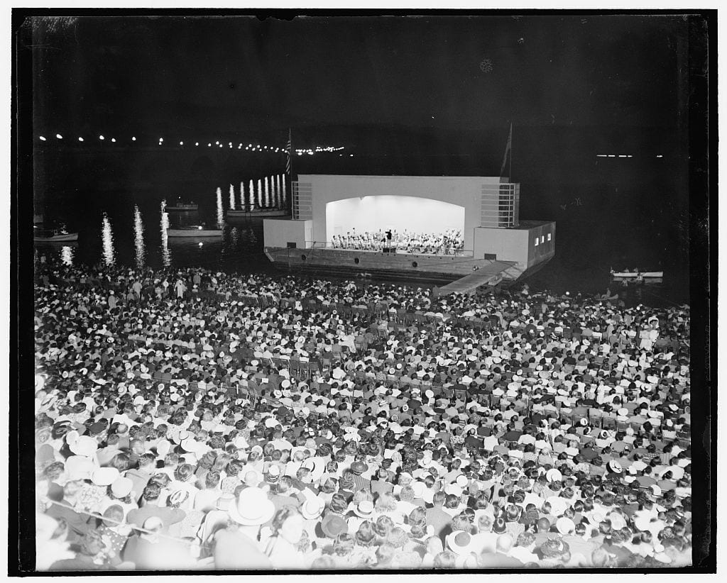 Washington turns out for open air music. Washington, D.C., July 12, 1939. Sitting on stone steps near the Lincoln Memorial here, and facing a barge moored in the Potomac River, thousands of Washingtonians turned out to listen to the first of a series of summer concerts by the Washington Symphony Orchestra under the direction of Dr. Hans Kindler tonight. To give it his blessing and to enjoy the music, President Roosevelt arrived shortly before intermission accompanied by Brig. Genl. Edwin M. Watson, military aide, and Mrs. Watson (Library of Congress)