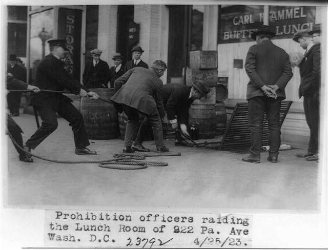 Prohibition officers raiding the lunch room of 922 Pennsylvania Ave - April 25th, 1923 (Library of Congress)