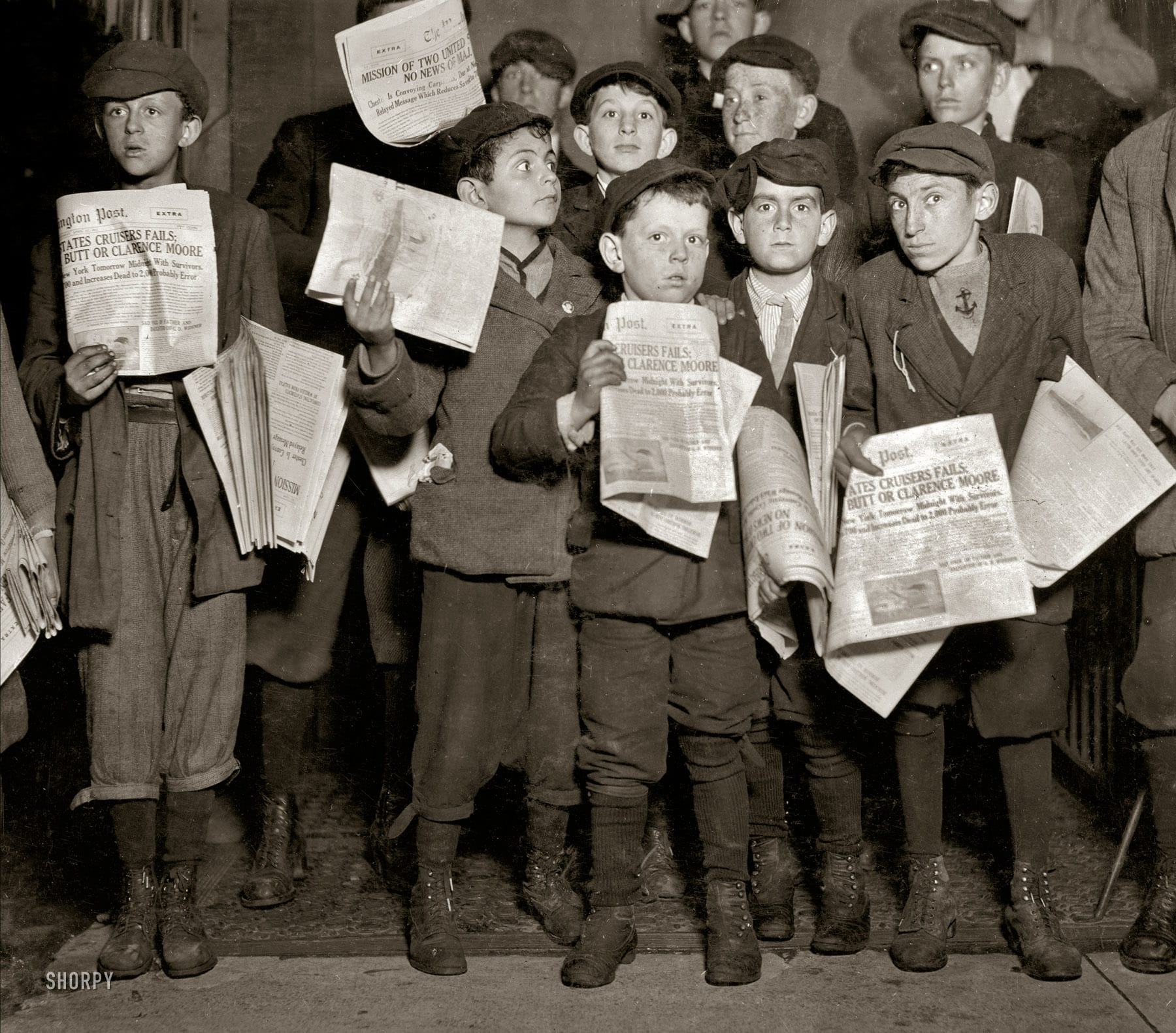 "Washington, D.C. -- news of the Titanic and possible survivors. ""After midnight April 17, 1912, and still selling extras, 12th Street near G. There were many of these groups of young newsboys selling very late these nights. Youngest boy in the group is Israel Spril (9 years old), 314 I Street N.W.; Harry Shapiro (11 years old), 95 L Street N.W.; Eugene Butler, 310 (rear) 13th Street N.W. The rest were a little older."" (Shorpy)"