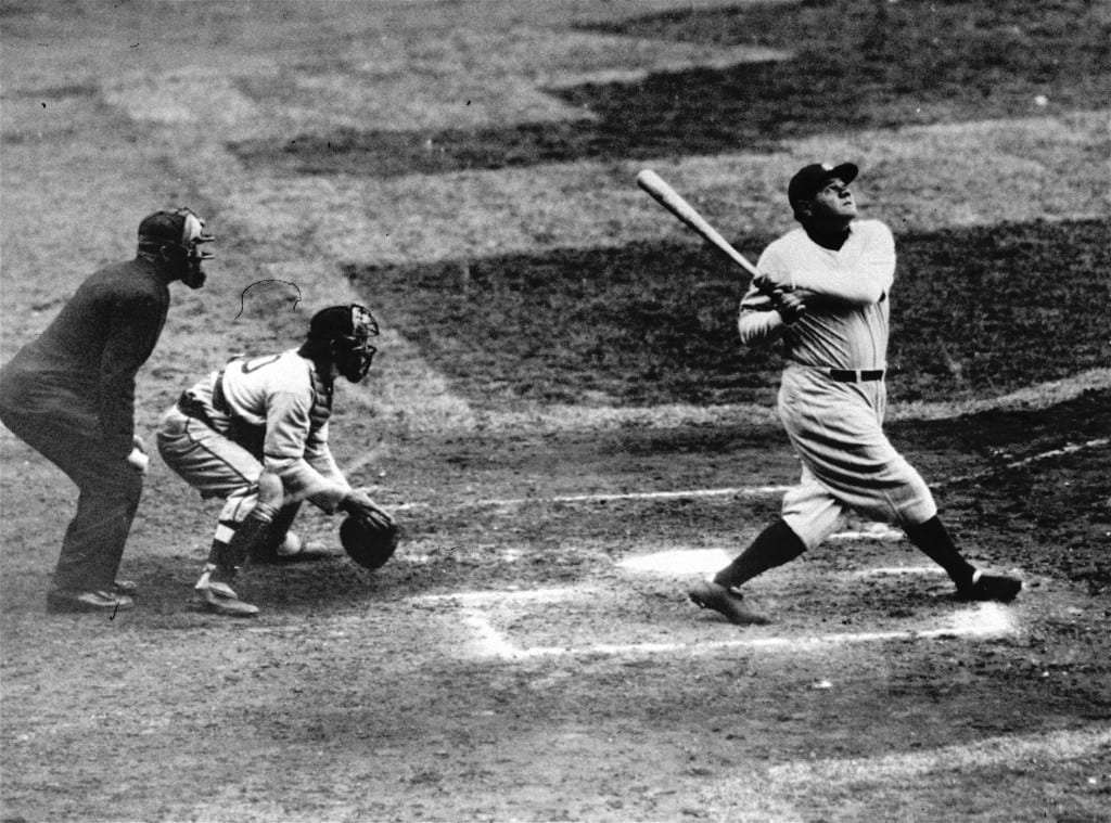 New York Yankees' Babe Ruth clouts a towering home run in this undated photo