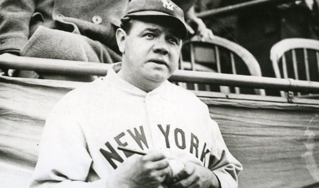 Babe Ruth signing a baseball in an undated photo