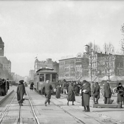 "Washington, D.C., circa 1919. ""Street scene, Pennsylvania Avenue."" Here we see the tower of the Old Post Office as well as a number of vanished Washington landmarks including the Parker Bridget department store."