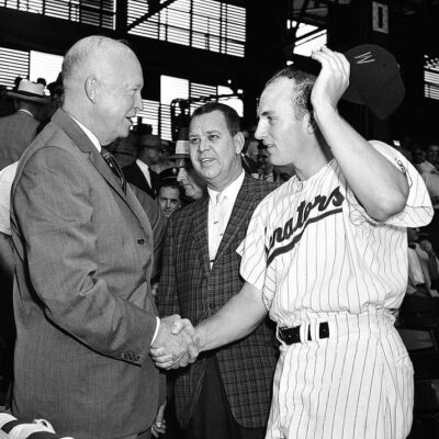 Harmon Killebrew shakes President Eisenhower's hand before a game in 1959 (Calvin Griffith in the middle)