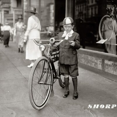 """Washington, D.C., 1921. """"Times boy and bicycle."""" Winner of a Mead Ranger bike by virtue of selling 30 newspaper subscriptions. The Ranger contest was a promotion of various papers from about 1917 to 1923. National Photo Co. Collection."""