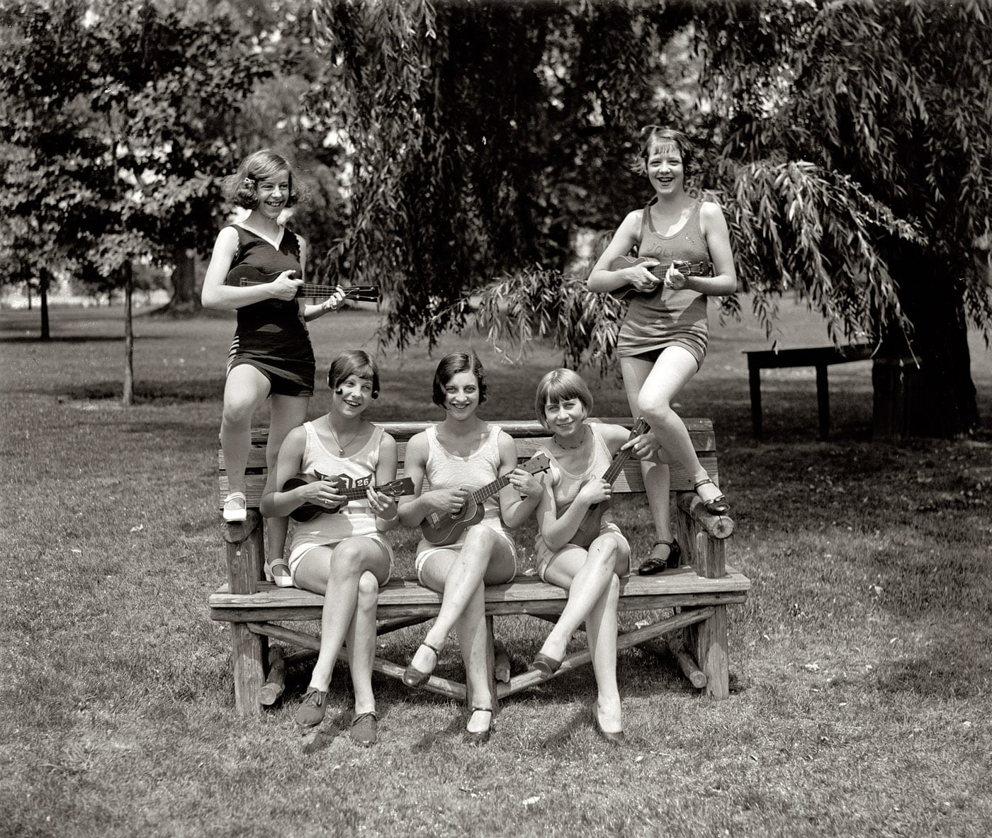 "July 9, 1926. Washington, D.C. ""Girls in bathing suits with ukuleles."" Identified in the caption of another photo as Elaine Griggs, Virginia Hunter, Mary Kaminsky, Dorothy Kelly and Hazel Brown. National Photo Co."