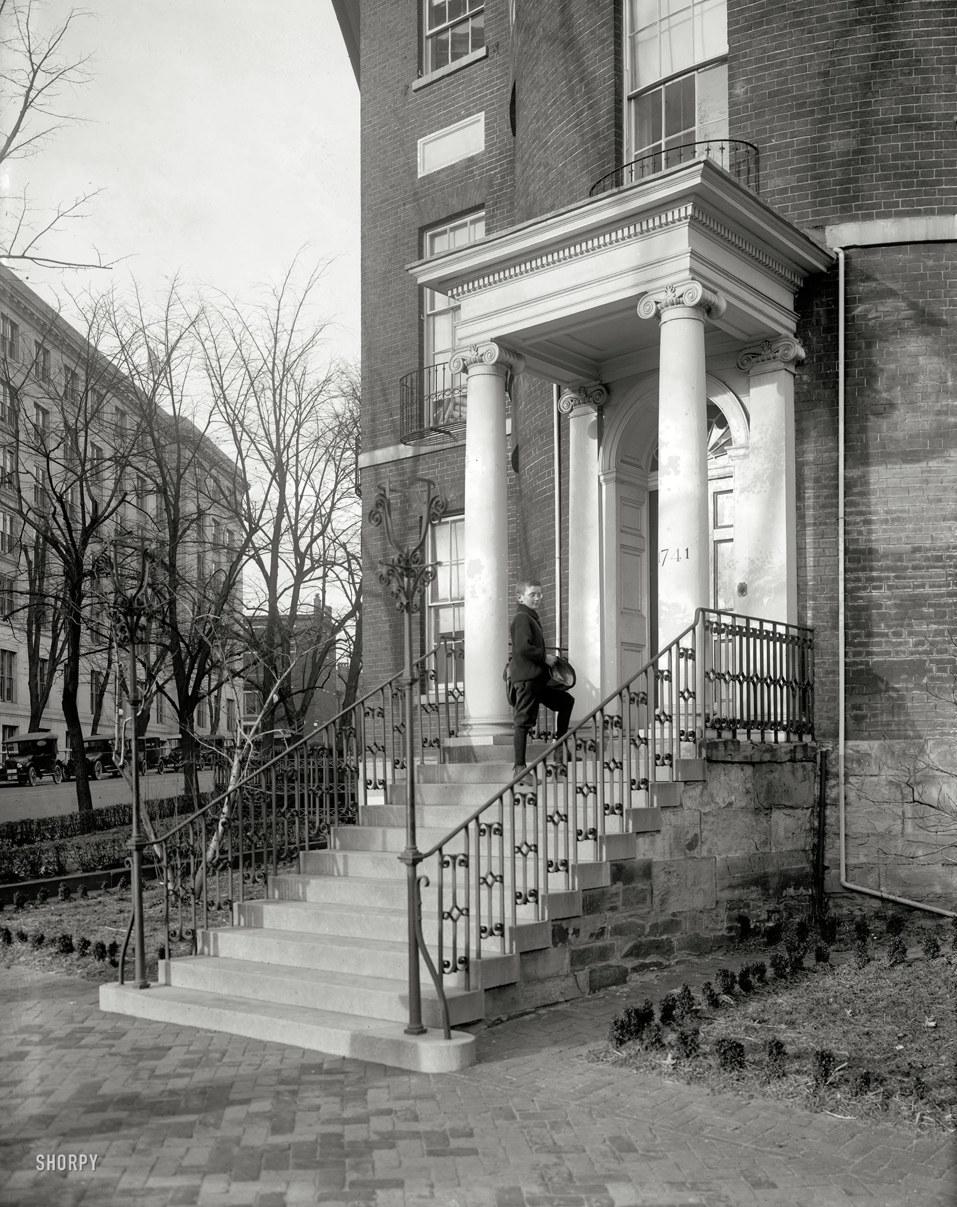 boy on the steps to the Octagon House in 1921