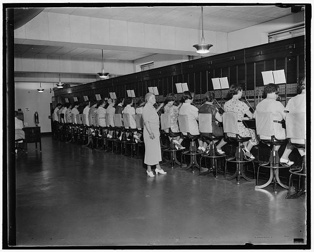 First Capitol telephone operator still on job. Washington, D.C., July 30. When Miss Harriot Daley was appointed telephone operator at the United States Capitol in 1898 there were only 51 stations on the switchboard. Today Miss Daley is Chief Operator and supervises a staff of 37 operators as they answer calls from 1200 extensions. The picture above shows the present switchboard with Miss Daley still on the job, 7/30/37