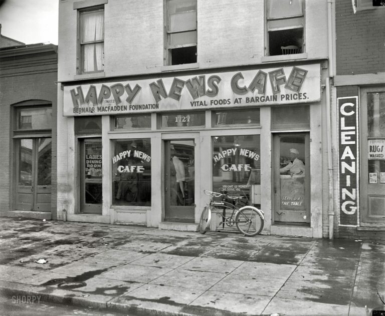"Washington, D.C., circa 1937. Exterior of the Happy News Cafe (described in a 1933 news item as ""the new dietitian restaurant for the unemployed"") at 1727 Seventh Street N.W. Harris & Ewing Collection glass negative."