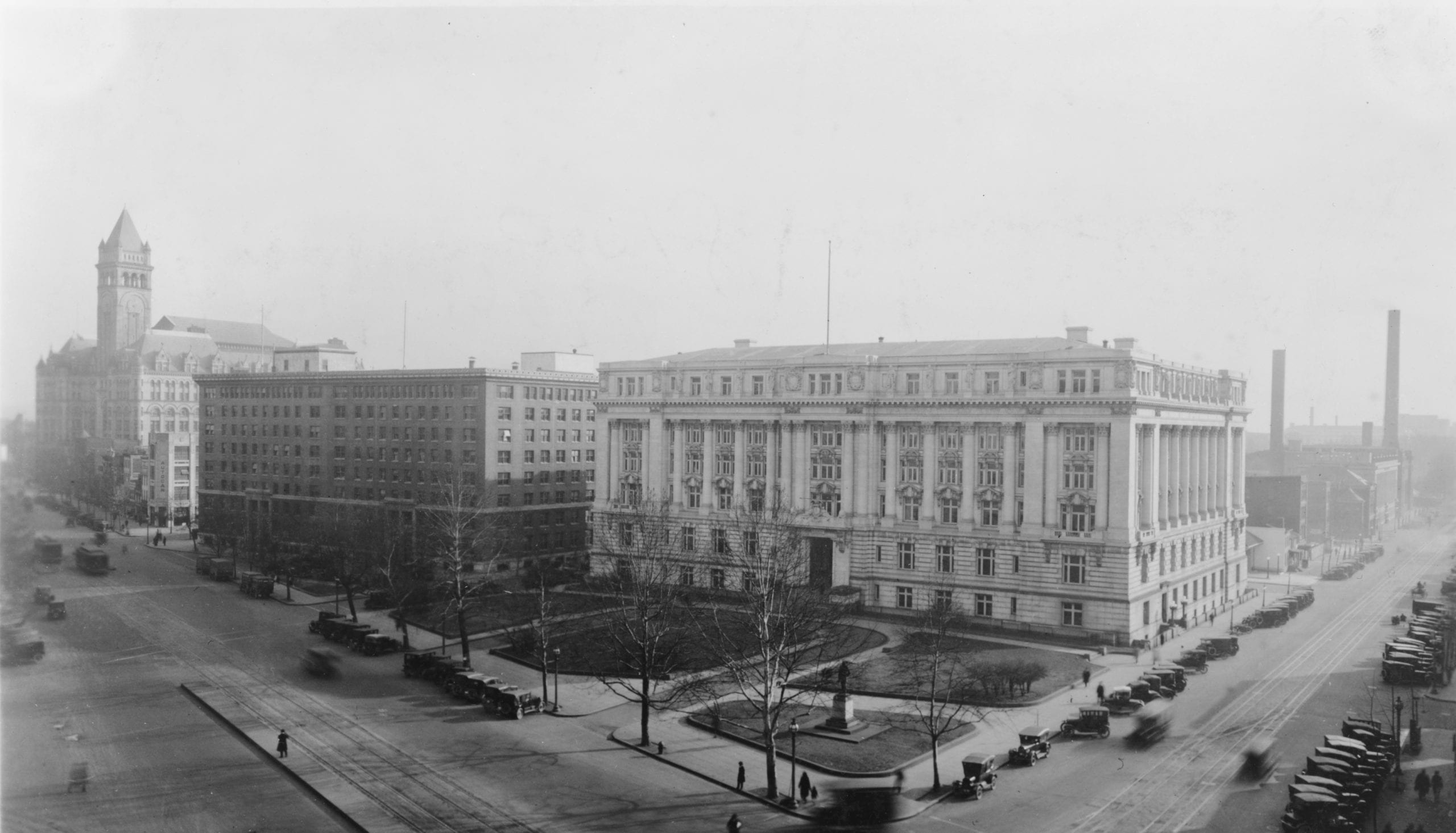 Looking southwest at the Old Post Office Pavilion (far left), Southern Railway Building (middle), and District Building on Pennsylvania Avenue NW in Washington, D.C., in 1932. On in the fall of 1932, the structures in rear of the District Building would be razed to make way for the U.S. Department of Labor building, whose cornerstone would be laid on December 15, 1932