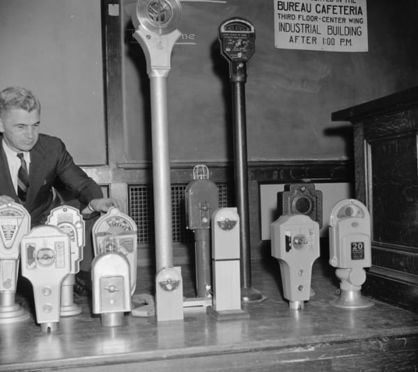 man checking out parking meters in 1938