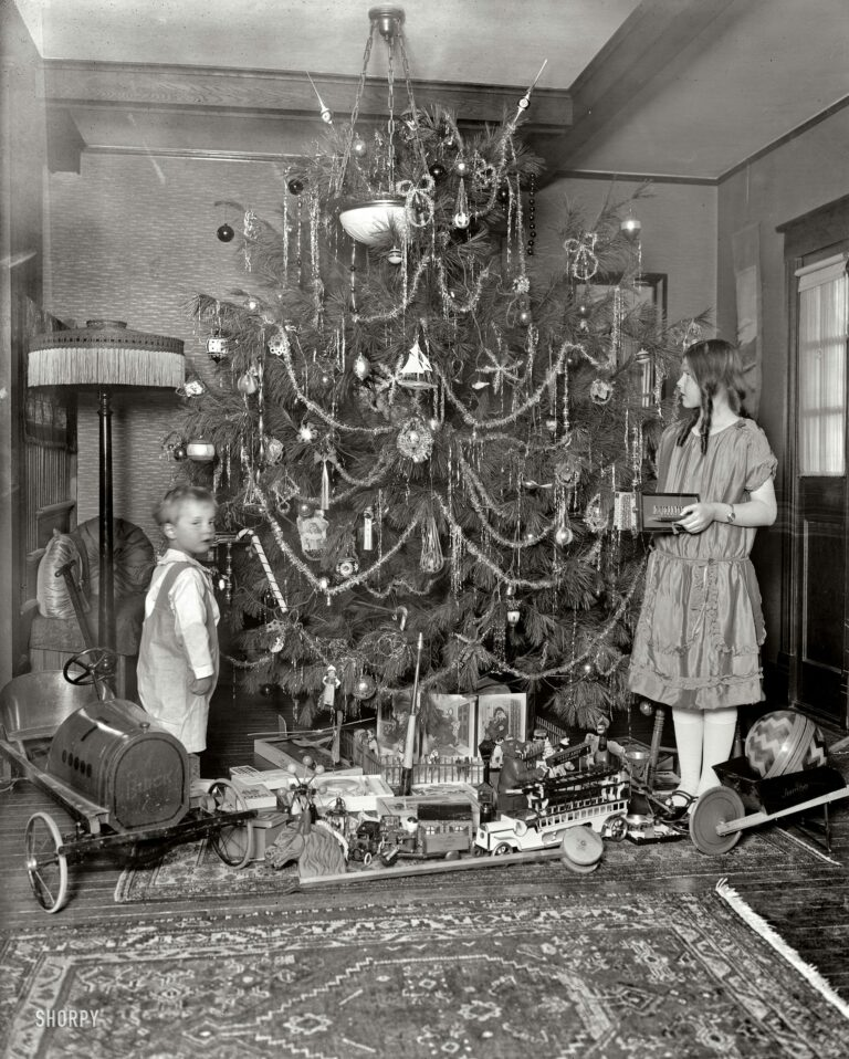 "Washington, D.C., circa 1920. ""Margaret Clark."" A Christmas tree with all the trimmings, and a Buick. Harris & Ewing Collection glass negative."