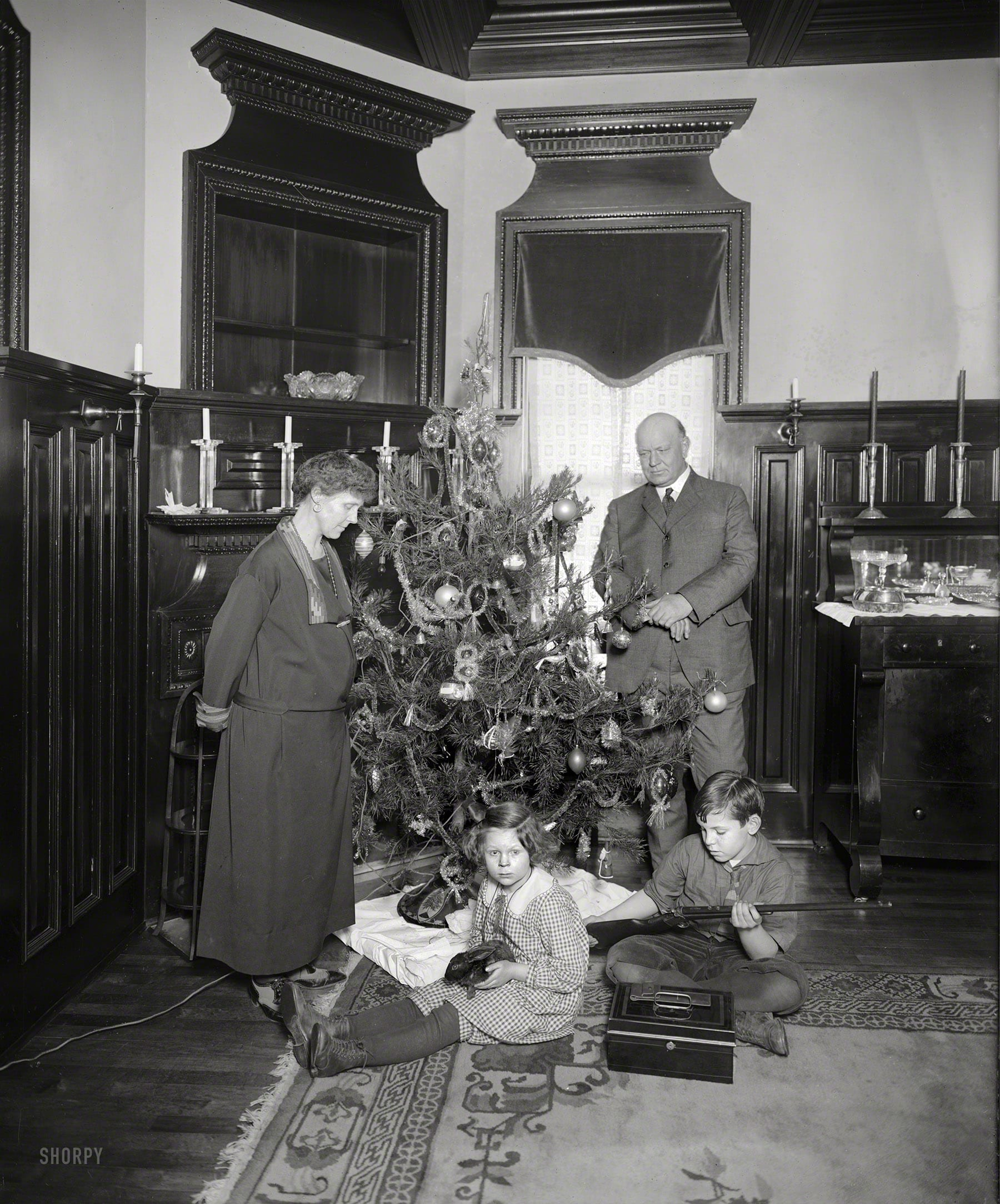 """Washington, D.C., circa 1922. """"Denby Christmas tree."""" Junior remembers this as the best Christmas ever! His gun-giving dad is Secretary of the Navy Edwin Denby. National Photo Company glass negative."""
