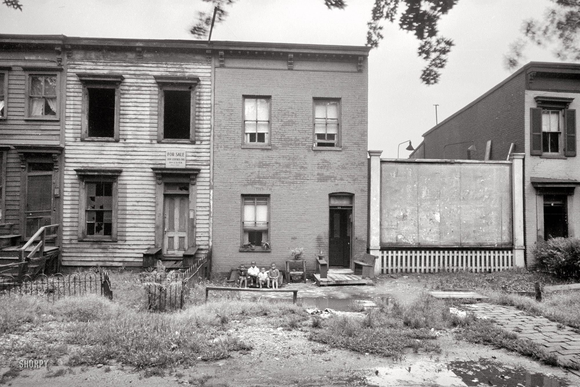 "Sept. 1935. Washington, D.C. ""Houses on Massachusetts Avenue near Union Station."" Photo by Carl Mydans, Resettlement Administration."