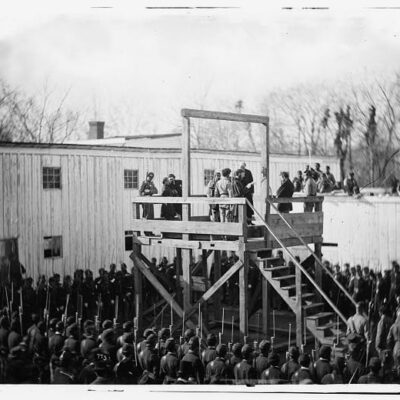 a death warrant being read to inmate Wirz on the gallows