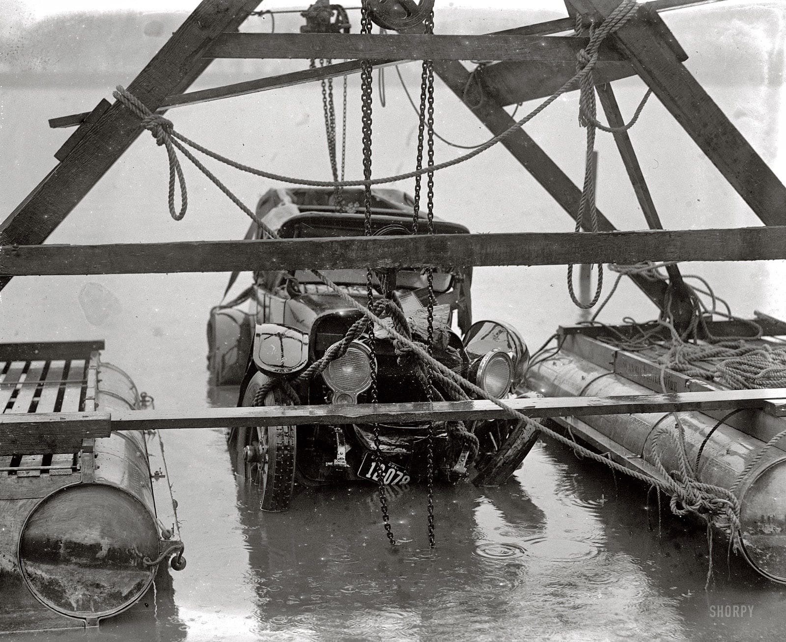 """""""Auto wreck. December 31, 1923."""" Continuing this week's theme of vehicular mishaps on (and off) the roads of Washington, D.C. On New Year's Eve, this car was in the drink. See the comments for details about this fatal accident in the Tidal Basin. National Photo Company Collection glass negative."""
