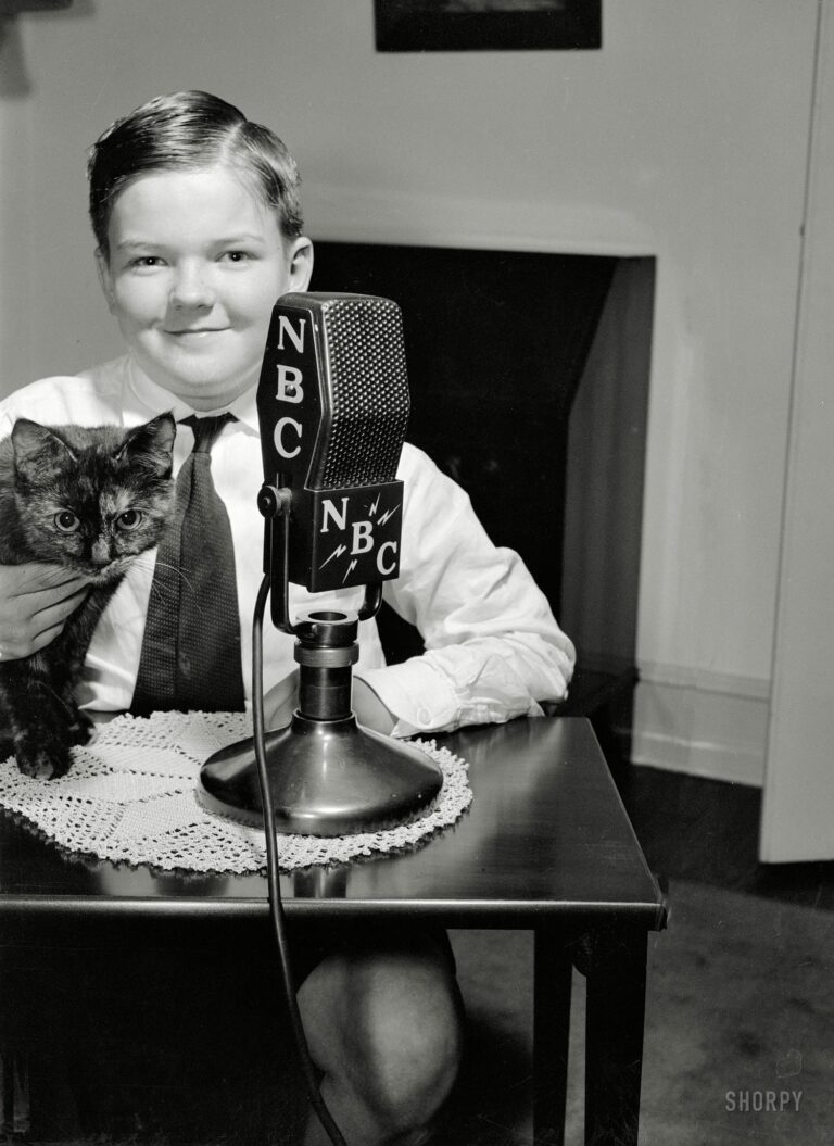 "Washington, D.C., circa 1938. ""Patrick Brennan, son of the Minister of Ireland, and Mrs. Brennan."" Or something like that. One of a series of photographs depicting children of various diplomats speaking from their homes to a radio audience. Harris & Ewing Collection glass negative."