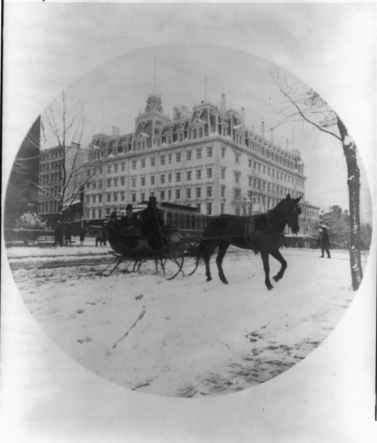 Photo shows a horse-drawn sleigh carrying what may be Melinda and Elise Painter across 14th St. at F St. in front of the Ebbitt House hotel. The modest buildings to the right of the grand hotel housed Newspaper Row, and just across the street at number 501 was Painter's office as Washington correspondent for the Philadelphia Inquirer. (Source: Ison article on Painter, 1990)