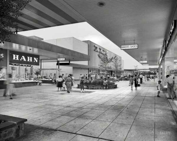 """May 29, 1959. """"Prince George Plaza, Hyattsville, Maryland. Night view."""" An actual mall (a long, open plaza) when it opened in 1959, the shopping center was enclosed in the 1970s and renamed the Mall at Prince Georges. Large-format safety negative by Samuel H. Gottscho."""
