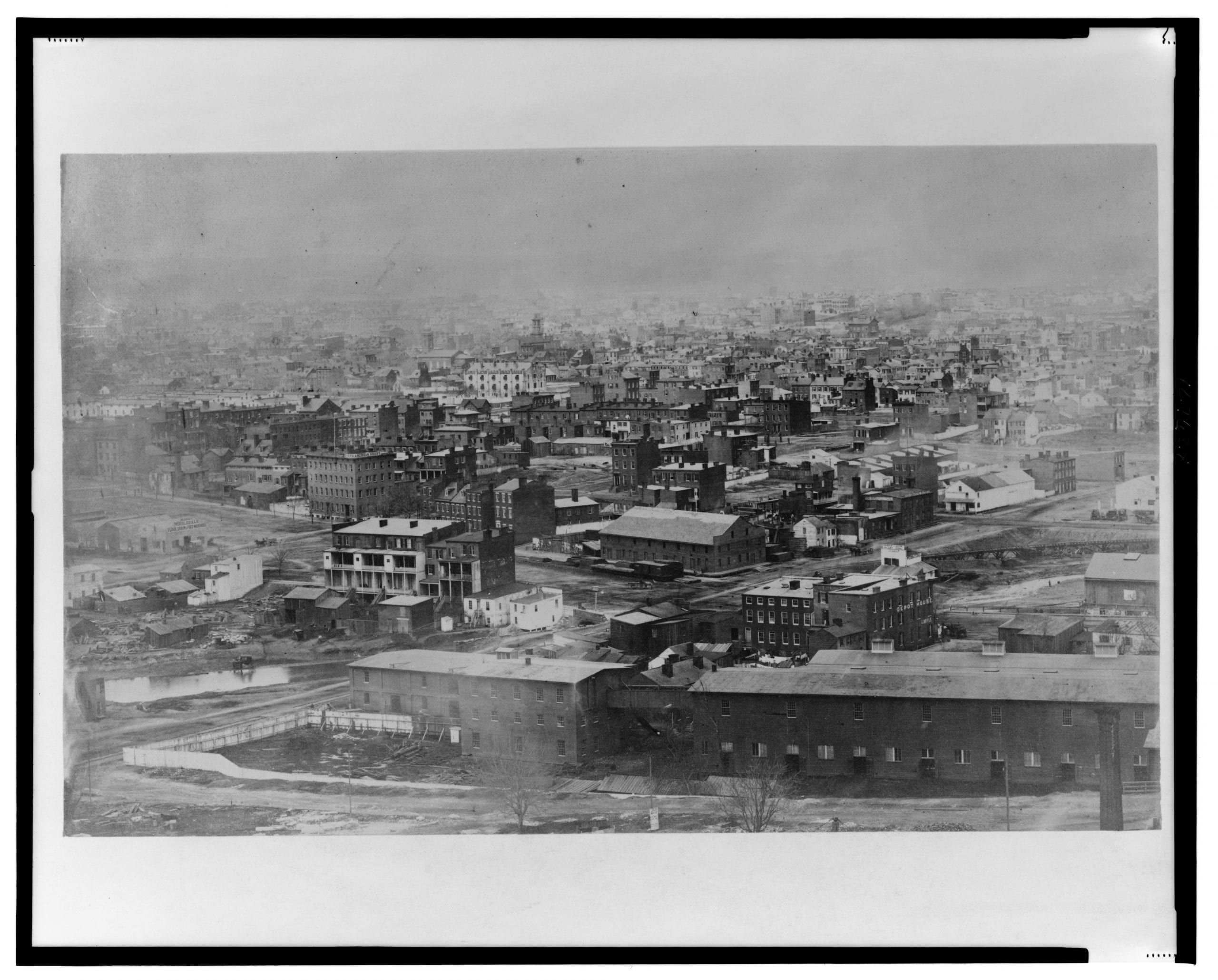 Northwest view with 1st, B, C, D streets, and Indiana Ave. in the foreground; view includes the Washington Jail, Aldrich's Wholesale Flour, Grain & Feed Warehouse, Dyers American House, Shamokin & Lykins Valley Coal (Wood & Coal), Depot House, C. Boyle, and Door, Sash & Blind Factory.