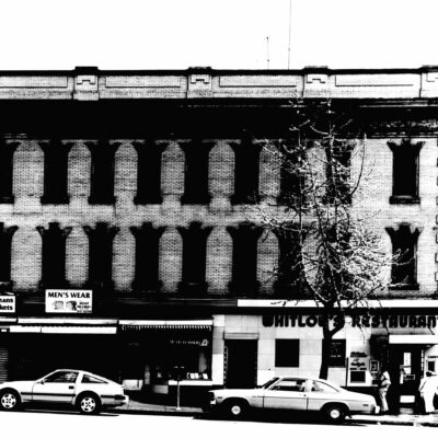 Whitlow's Restaurant and retail stores at 11th and E Streets, N.W., Washington, D.C., photographed before they were demolished to make way for new buildings