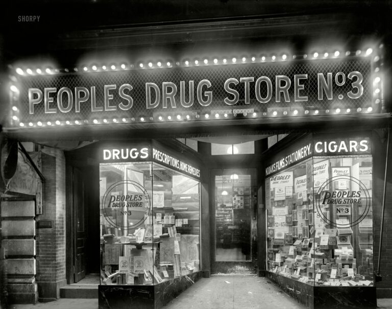 """Washington, D.C., circa 1920. """"Peoples Drug Store, 14th & U."""" A nighttime view of the store seen here and here and here. Your headquarters for """"tar bags."""""""